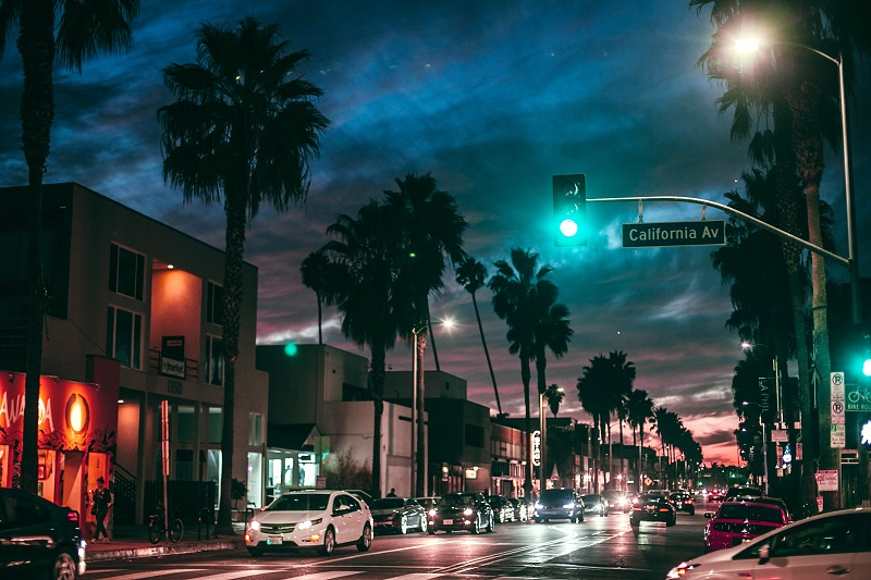 Driving Lessons in Newport Beach Distant View of a Busy City Street at Night